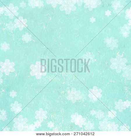 Christmas background with old paper texture of blue color and snowflakes