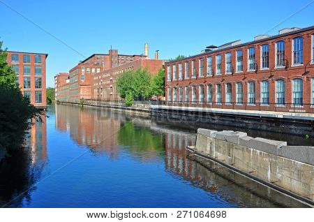 Pawtucket Canal And Historic Mill Buildings In Lowell National Historic Park In Downtown Lowell, Mas