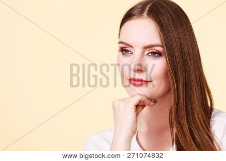 Relaxation, Time To Think Concept. Attractive Smiling Melancholy Woman In Brown Hair With Full Makeu