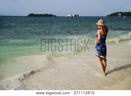 Young girl enjoying the carribean landscape, Colombia, South America