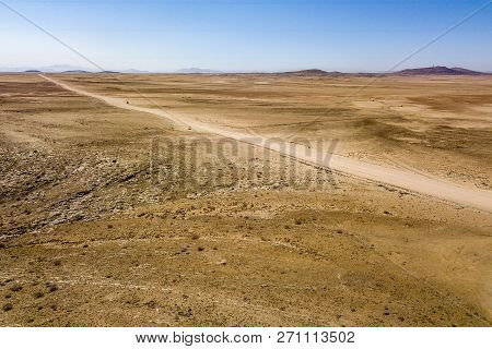 The road C14 in gobi desert near Kries se Rus Campsite of Namibia. poster