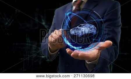 Businessman Shows Concept Hologram 3d Family Car On His Hand. Man In Business Suit With Future Techn