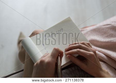 Top View Of Women Hands Writing Goal For New Year Or Christmas