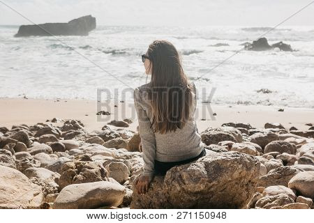 The Girl In Solitude Admires A Beautiful View Of The Atlantic Ocean In Portugal. Search For Soul Or