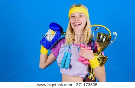 Fitness Champion. Champion Concept. Girl Successful Modern Woman Hold Golden Goblet Of Champion. Wom