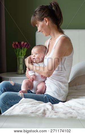 A Happy Mother And Her Cute Baby
