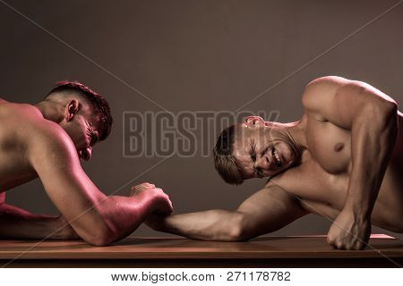 Revenge In Sport. Twins Competitors Arm Wrestling. Men Competitors Try To Win Victory Or Revenge. Tw