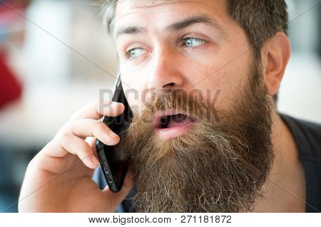 Communication Concept. Man With Beard And Mustache Mobile Phone Conversation Defocused Background. B