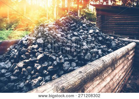 Coal Mine Wagon. Pile Of Charcoal In Wooden Trolley, Closeup