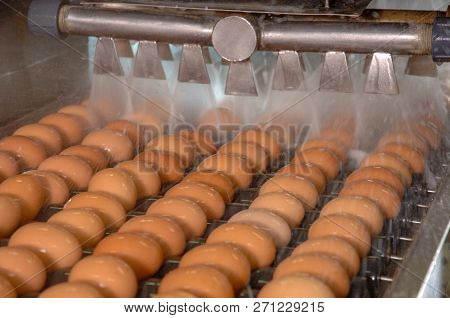 Egg Factory On Washing Production Line With Fresh Eggs Are Prepare For Package In Automate Food Proc