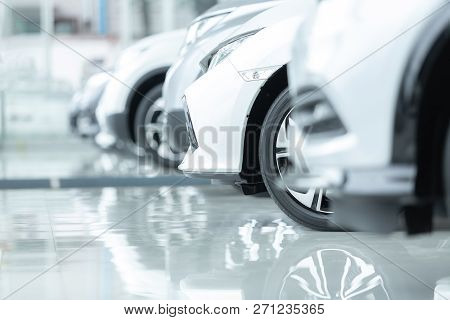 poster of Cars For Sale, Automotive Industry, Cars Dealership Parking Lot. Rows of Brand New Vehicles Awaiting New Owners, on the epoxy floor in new car service