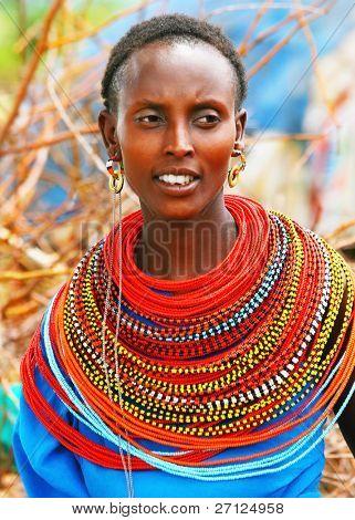 AFRICA,KENYA,SUMBURU,NOVEMBER 8: Portrait of Sumburu  woman wearing traditional handmade accessories,  review of daily life of local people, near Sumburu Park National Reserve, November 8, 2008, Kenya