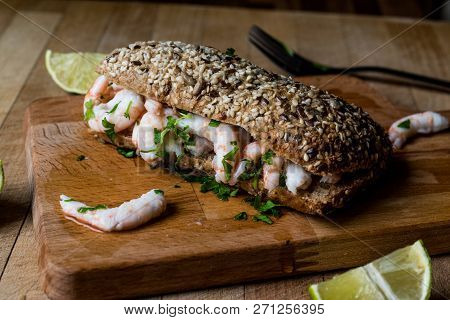 Shrimp Sandwich With Lime On Wooden Surface. Fastfood Concept.