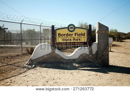 San Ysidro, California - 11/26/2018: Signs seen at the US/Mexico border. Warning, Do not cross, Directional and Location signs at the border between the USA and Mexico. Close to San Diego California.
