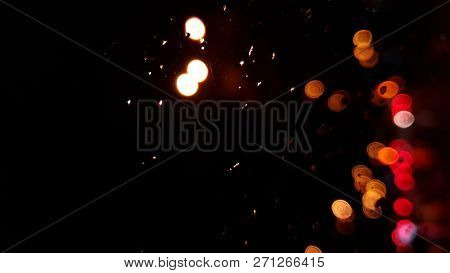 Rain Drops On Window With Road Light Bokeh, City Life In Night In Rainy Season Abstract Background,