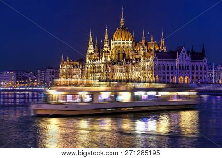 Parliament Building Of Budapest Above Danube River In Hungary At Night.