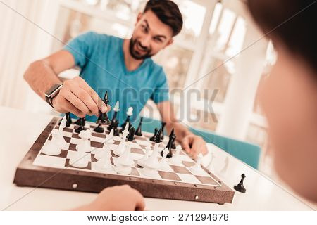 Bearded Father And Son Playing Chess On Table. Happy Family Concept. Board On Table. Young Boy In Sh
