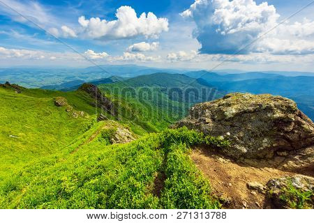 Boulders On Top Of The Ridge With Grassy Humps And Hills. Spectacular View Of Wide Landscape Spread