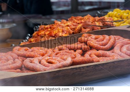 Hecha, Ukraine - Jan 27, 2018: Pork Butchers Competition. Traditional Sausages In Huge The Wooden Tr