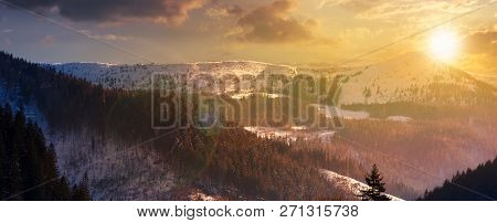 Panorama Of Mountain Ridge And Forested Hills At Sunset. Lovely Winter Scenery