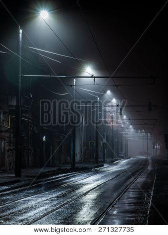 Street Lights Foggy Misty Night. Tram Route On A City Street