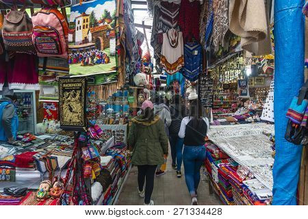 Machu Picchu, Peru - Sep 15, 2018: Tourists Visiting A Market Selling Handcrafts An Textiles Near Ma