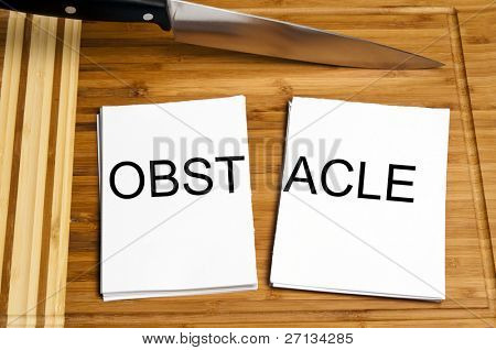 Knife cut paper with obstacle word