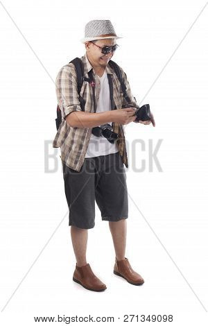 Traveling people concept. Portrait of Asian male backpacker tourist wearing hat, black sunglasses, camera and backpack isolated on white. Full body portrait. Broke empty wallet poster