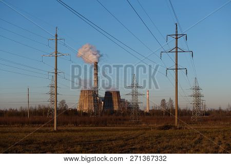 Power Indusrial. Thermal Power Plant. Industrial Landscape. Pipes Of The Power Station Smoke Against