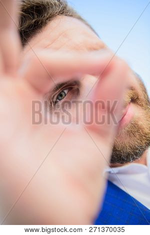 Guy Looks Suspicious Through Ok Gesture Close Up. Excellent Concept. Spying Watching And Observing.