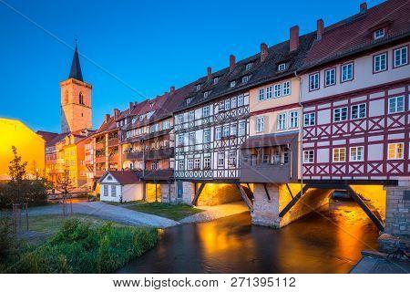 Classic Panoramic View Of The Historic City Center Of Erfurt With Famous Krämerbrücke Bridge Illumin