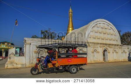 Nyaungshwe, Myanmar - Feb 8, 2017. A Local Bus On Street Near White Temple Of Shwe Yan Pyay Monaster