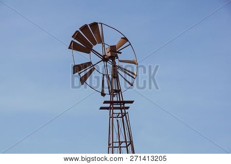 Vintage Toned Photo Of An Old Western Windmill Tower, American Wild West Symbol .