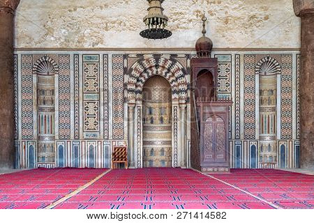 Cairo, Egypt - January 3 2018: Colorful Decorated Marble Wall With Engraved Mihrab (niche) And Woode