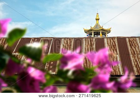 Architectural detail from exterior view of the Buddhist temple in near Bangkok, Thailand