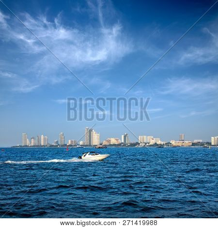 cityscape of modern architecture buildings with blue sea water and speedboat over blue clear sky in downtown Pattaya, Thailand