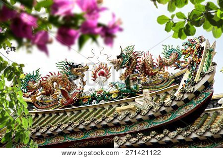 Close up architectural detail from colorful Chinese buddhist temple of Kuan Yim Shrine in Bangkok, Thailand