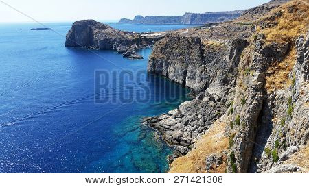 Views Of The Bay Of The Mediterranean Sea In The Town Of Lindos. The Island Of Rhodes. Greece.
