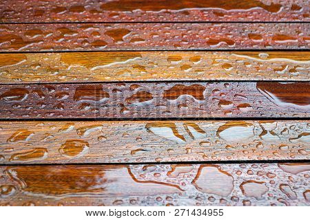Water Drops On A Wooden Floor Surface.drop Of Water On Wood With Raindrop After A Rain With Copy Spa