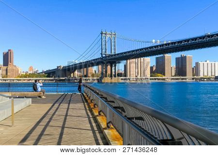 New York, Usa - June 20, 2015: The Brooklyn Bridge. Walk On The Bridge. Walking Through The Streets
