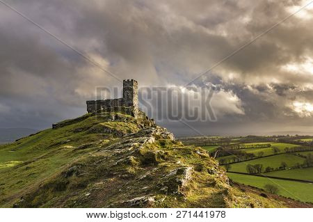 Stormy Sunset At Brentor Church With Wild Looking Sky, Devon, Uk