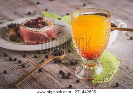 Glass With Orange Juice On Wooden Board With Whole Camembert