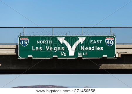 Las Vegas Interstate 15 and 40 freeway arrow sign in the Mojave desert near Barstow, California.