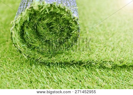 Artificial Turf Roll. Synthetic Grass Lawn Laying Background.