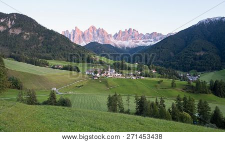 Alpine Village With Dolomites Mountains On Background