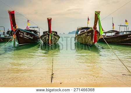 Krabi, Thailand - November 2018: Thai Traditional Wooden Boats With Ribbon Decoration At Ocean Shore