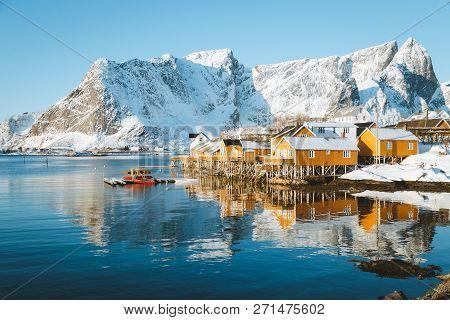 Beautiful View Of Scenic Lofoten Islands Archipelago Winter Scenery With Traditional Yellow Fisherma