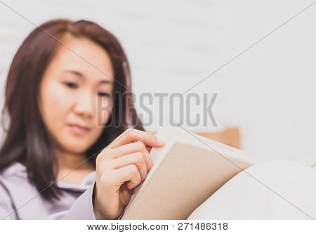 Women Read Book To Learning On Bed In Bed Room In The Morning