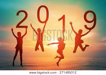 Happy New Year Card 2019 Retro Or Lomo Style. Silhouette Of Children Girl  Jumping On Tropical Beach