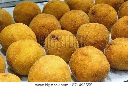 Sicilian Croquettes Of Rice Called Arancini In Italian Language Stuffed With Tomato Mozzarella And R